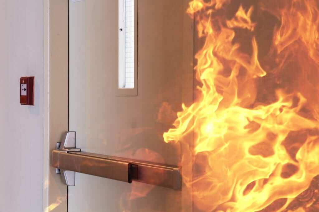 Fire,Burning,In,Front,Of,The,Closed,Door.
