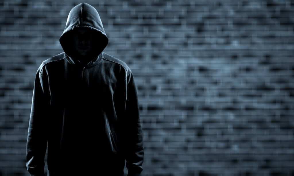 Thief,In,Black,Clothes,On,Grey,Background